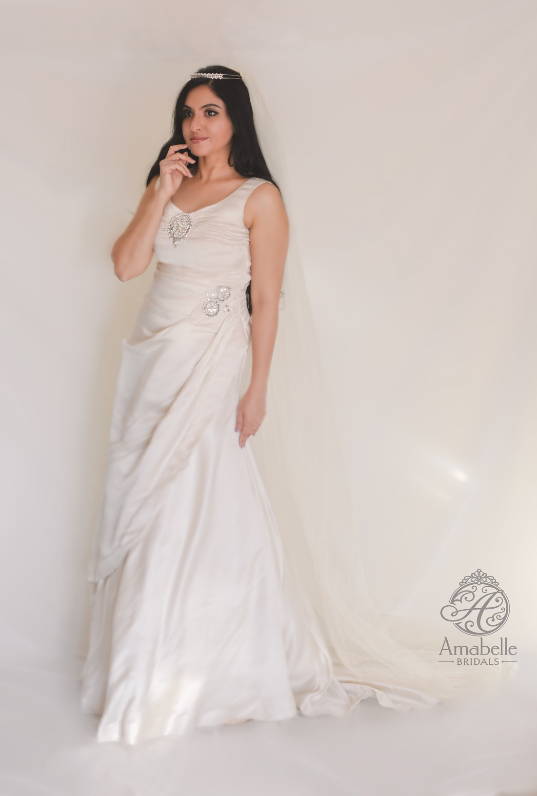 Ivory Duchess satin draped wedding gown