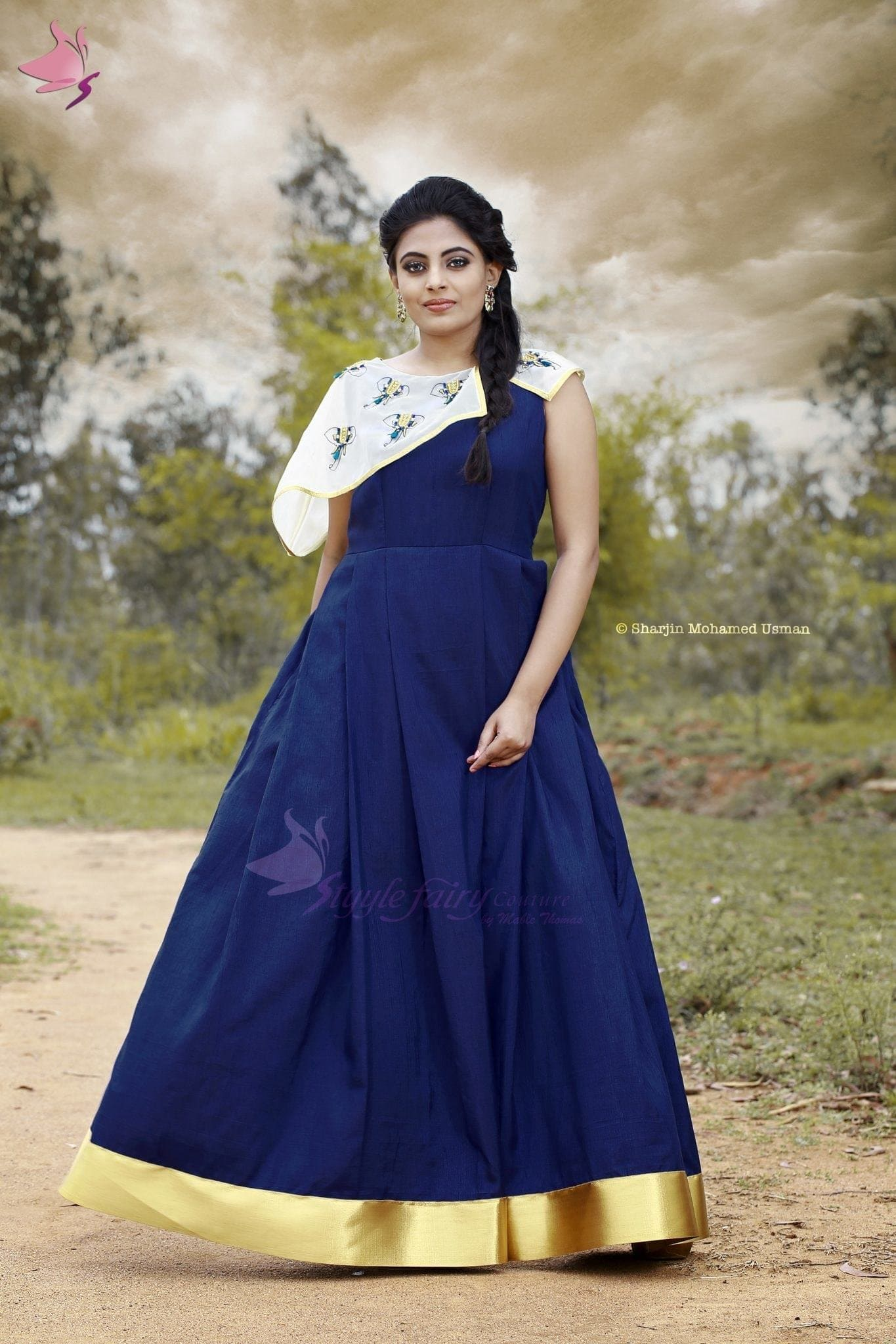 Blue cape attached pleated gown