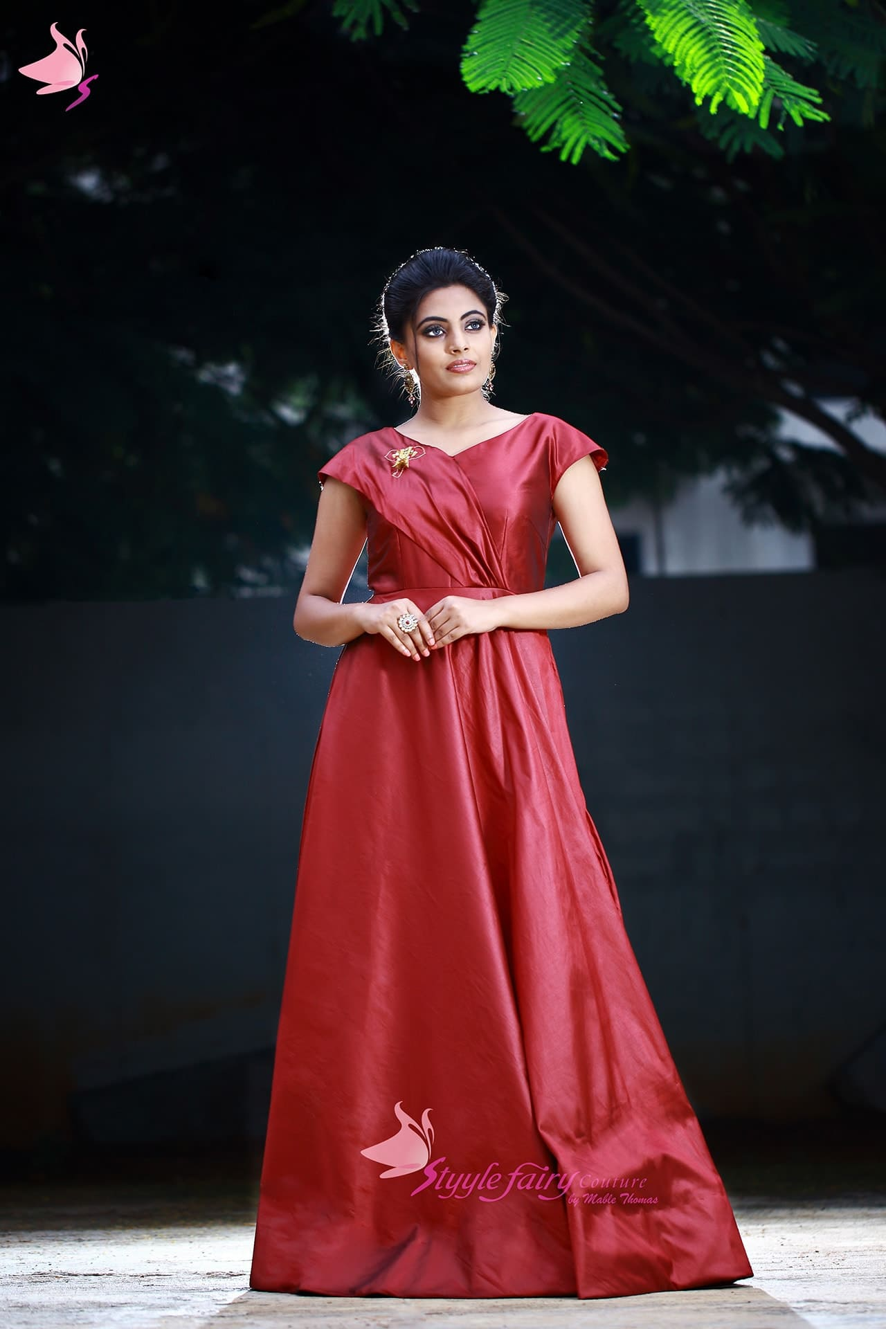 Maroon art silk gown with draped yoke and raglan sleeve