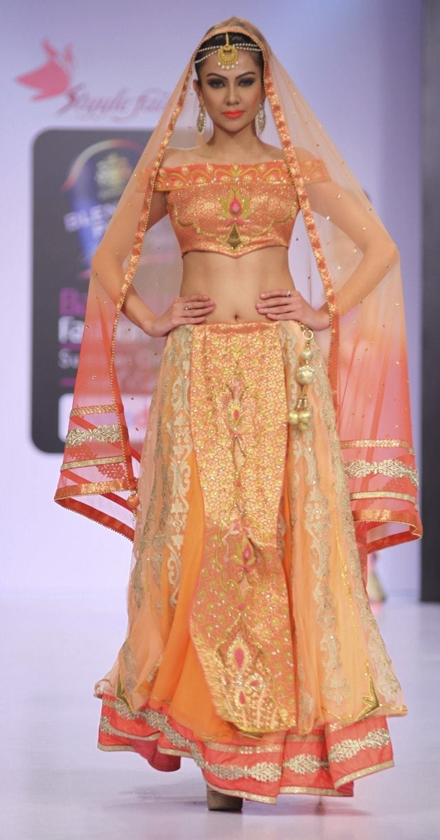 Ombre effect peach and coral heavy bridal lehenga