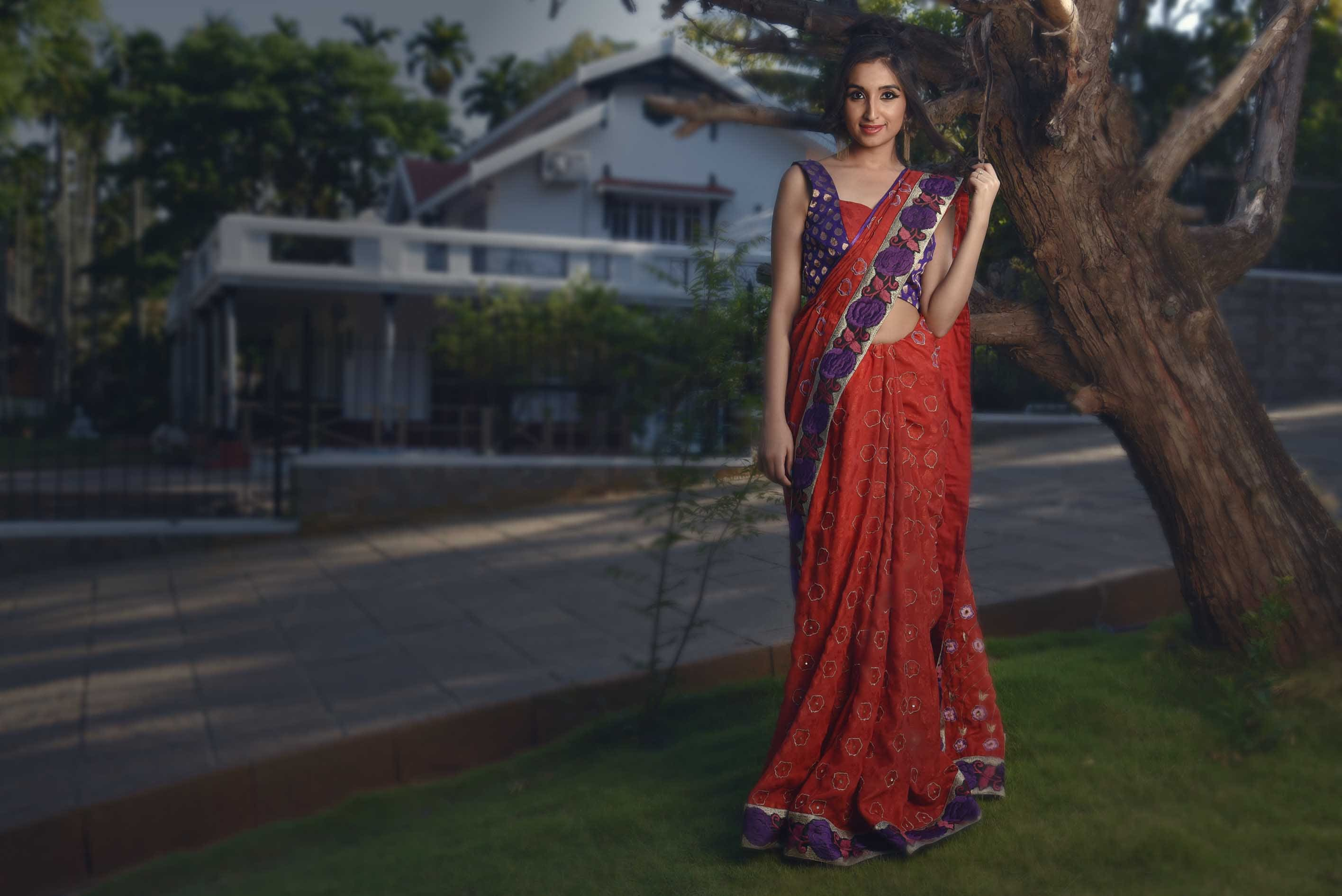 Red jacquard crepe with purple border sari