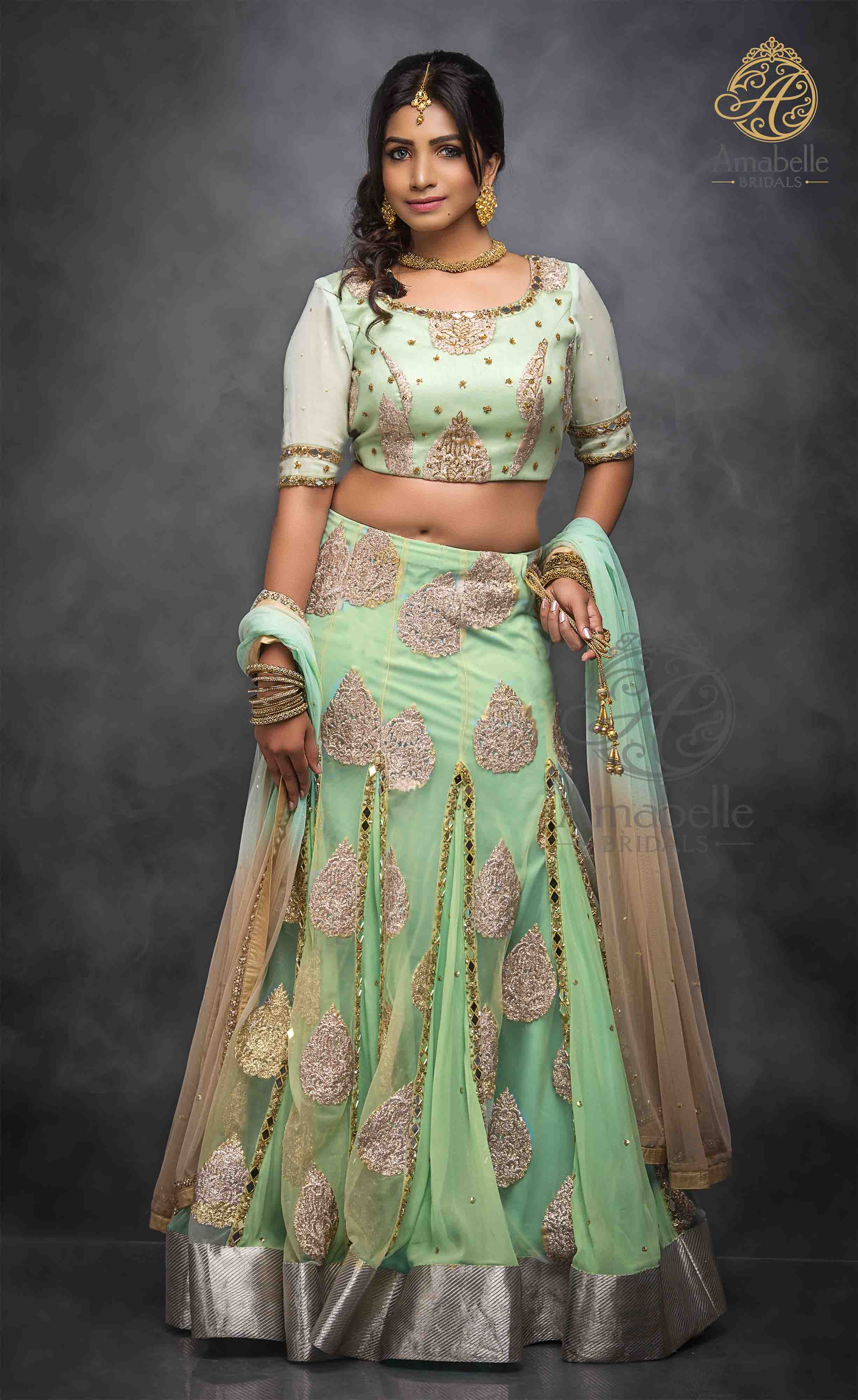 Apple green mirror and Zardozi hand embroidered Lehenga Choli
