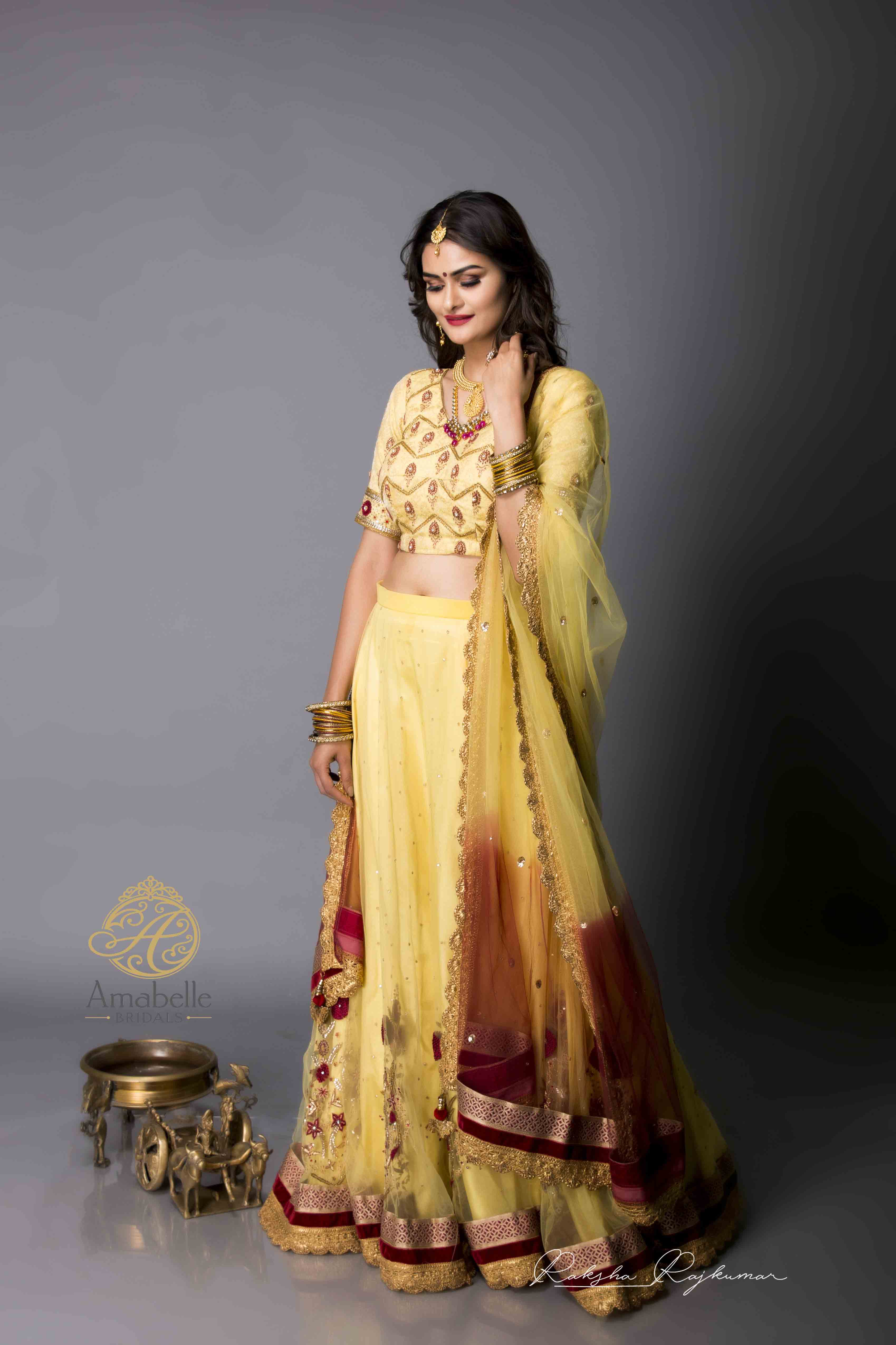 Pale yellow brocade and net flared lehenga choli dupatta set